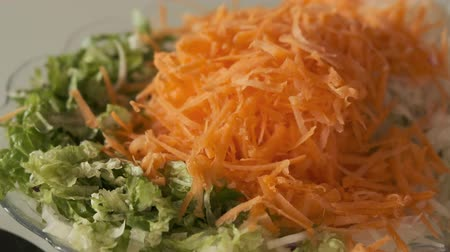 ralado : winter salad, grated lettuce and carrot radish, Stock Footage