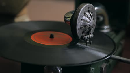 gravar : Turntable playing vinyl close up with needle on the record