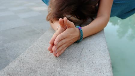 şükran : Womans hands with bracelets together symbolizing prayer and gratitude. Mudra. Yoga concept. Camera movement from left to right. Slow motion.