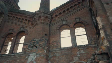 defunct : The facade of the old beautiful destroyed brick building. Ruins of an abandoned architectural object