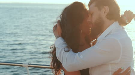 cubano : Energetic attractive young hispanic couple dancing latin Bachata near sea or ocean. Sunlight background. Summer time, romantic footage. Slow motion.