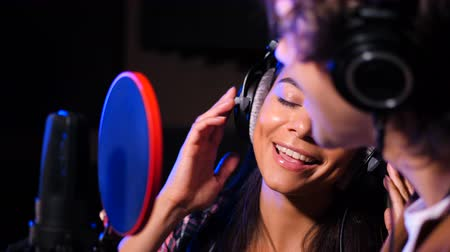 mc : Two young singers performing their song in record studio. Professional musician duet recording new album CD. Beautiful couple working together. Slow motion. 4k