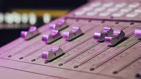 knob : Professional Recording Studio. Interface of equipment for sound processing. Fader. Different modes of audio console. Process of working on song or voice. Neon violet knob light