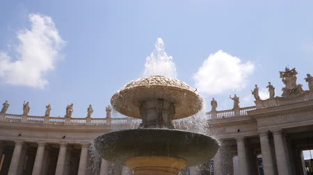 bernini : Old fountain and beautiful building with columns. Slow motion. Architecture and landmark of Vatican. Water drops splashing and dripping on fountain surface in european city. Stock Footage