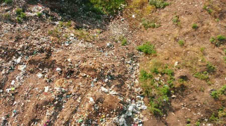 hijenik olmayan : City Dump concept. Aerial Drone View. Environmental pollution. Plastic bottles, bags, trash in green field. Nature polluted from activities of irresponsible people.