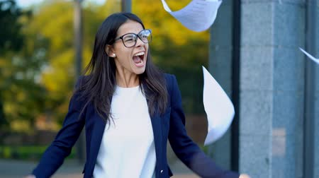nervous breakdown : Angry furious female businesswoman screaming in anger. Stress management, mental distress problems, losing temper, reaction on failure. throwing crumpled paper, having nervous breakdown at work. Stock Footage