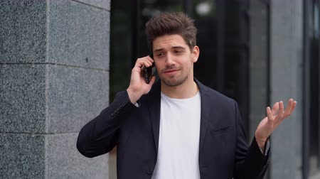 casual wear businessman : Businessman have conversation using mobile phone. Business guy in formal suit gladly talks with colleague. Office employee, wage worker, weekdays concept