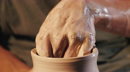 молдинг : Unknown craftsman creates jug. Focus on hands only. Small business, talent, inspiration concept. Overhead view. Working process of mans work at potters wheel in art studio.