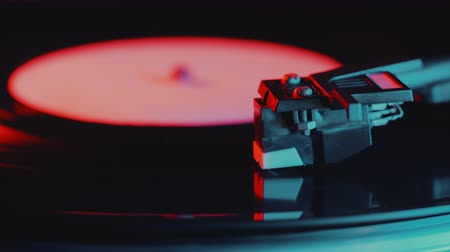 rock album : Retro-styled spinning record vinyl player. 4k. Close up. Rotating vintage phonograph close up. Beautiful colorful movie. Neon led light. Stock Footage
