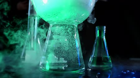 carbon dioxide : The concept of chemistry tests demonstration and experiments. Edutainment. Flask with colorful liquid are steaming in neon light. Beautiful chemical reaction with dry ice in water.