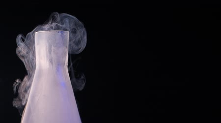martinis : Flask with liquid nitrogen on black background. Concept of chemical experiments and tests. Edutainment.