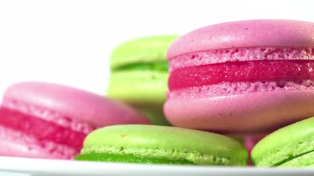 macarons : Colorful macaroons rotating, horizontal view. Cooking, food and baking, pastry shop concept. French macarons - meringue cookies with ganache or buttercream filling. Stock Footage