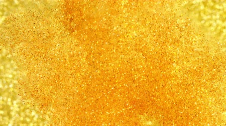 limpar : Glitter in water. Gold paint reacting in water creating abstract cloud formations.Can be used as transitions,added to modern projects,art backgrounds, anything with creative twist