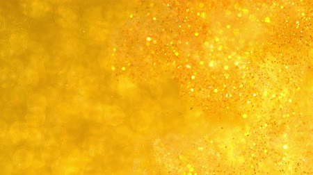 limpar : Sparkles in water. Gold glitter reacting in water creating abstract cloud formations.Can be used as transitions,added to modern projects,art backgrounds, anything with creative twist