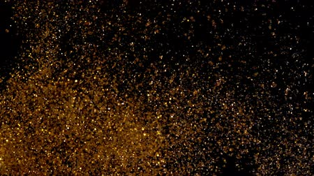 limpar : Beautiful abstract texture. Gold shining sparkles on black. Copper particles move chaotically under water. Golden background. Can be used as transitions in projects.