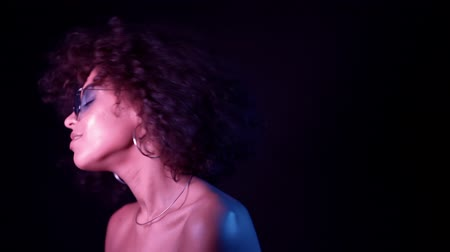 かつら : Young african girl with curly hair dancing in neon light. Tempting woman with perfect make-up smiling, enjoying moment, music. Glamour, fashion, style concept