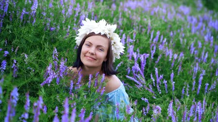 krans : Girl in blue linen dress smiling and flirting.Attractive woman in lavender field