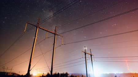 milkyway : Incredible night sky with stars passing over power line in long exposure timelapse. Beautiful panorama view. Nature in the countryside. Astrophotography.