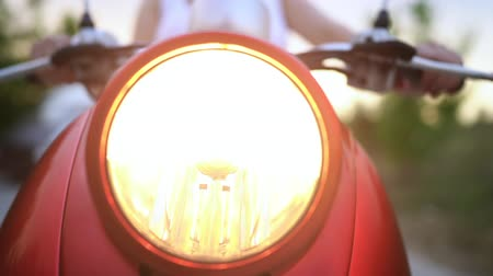 motorino : Closeup of headlight of red retro motorcycle, moped or scooter. Dolly shot. Filmati Stock