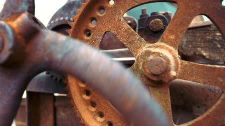 fogaskerék : Industrial mechanism. Steampunk, time, old, clock concept. Big metal rusty gears rotating close-up view.