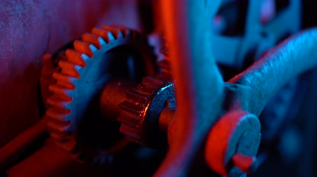ticker : Steampunk, time, old, clock concept. Neon light. Industrial mechanism. Big metal rusty gears rotating close-up view. Stock Footage