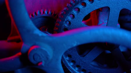 going round : Abstract movement of grunge industrial clock gears in neon light. Time, mechanical engineering, work concept Stock Footage