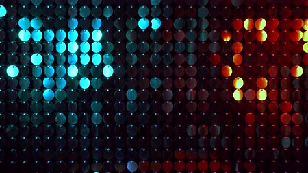 kinetik : Shiny kinetic surface panel illuminated by gold and turquoise light in luxury boutique. Flickering background for interruptions or text savers. Mirror sequins sway by wind blowing.