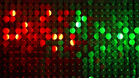 kinetik : Red and green sparkles shining reflective background. Abstract kinetic glitter wall moving. Night club decoration. Can be used as transitions, added to modern projects,art backgrounds. Stok Video