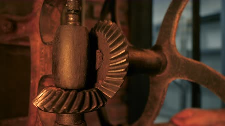 век : Time, old, clock concept. Industrial mechanism. Big metal rusty gears rotating close-up view.