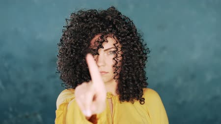 bastante : Denying, Rejecting, Disagree, Portrait of Beautiful Girl. Body language. Woman with curly hair disapproving with no hand sign make negation finger gesture