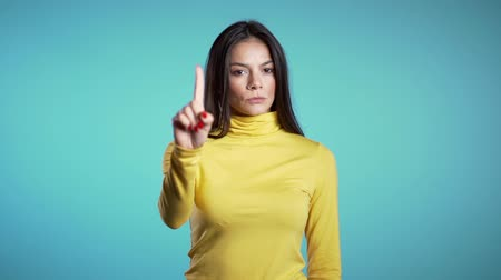 denying : Latin woman disapproving with no hand sign make negation finger gesture. Denying, Rejecting, Disagree, Portrait of Beautiful Girl. Slow motion.