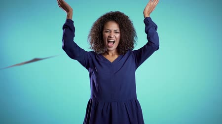 kiegészítés : African businesswoman throwing papers documents into air and celebrates success on blue background. Freedom, successful completion of project concept.