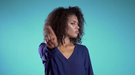 attitude : Business woman disapproving with No Hand Sign Make Negation Finger Gesture. Denying, Rejecting, Disagree, Portrait of Beautiful African Girl. Slow motion.