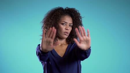 bastante : Angry annoyed woman raising hands up to say no stop. Sceptical and distrustful look, feeling mad at someone. Afro girl facial expressions, emotions and feelings. Body language