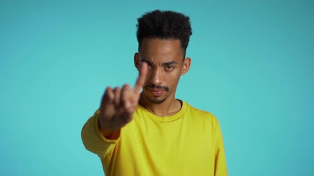 книжный шкаф : Denying, Rejecting, Disagree, Portrait of handsome guy. African american man disapproving with no hand sign make negation finger gesture. Slow motion.