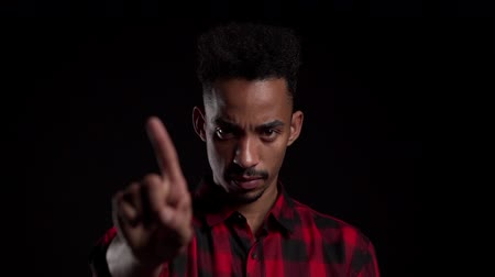 denying : African american man disapproving with no hand sign make negation finger gesture. Denying, Rejecting, Disagree, Portrait of handsome guy. Slow motion.