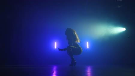 sexualita : Amazing woman dancing in neon light. Professional dancer sexually moving to the music rhythm. Slow motion.