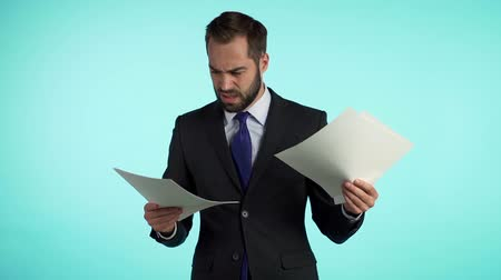 looking distance : Serious businessman tearing contract in pieces. Angry furious male office worker throwing crumpled paper, having nervous breakdown at work, screaming in anger, stress management. Stock Footage