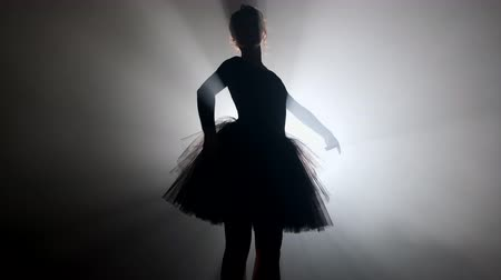 tüt : Young ballerina on smoke stage dancing modern ballet. Performs smooth movements Stok Video