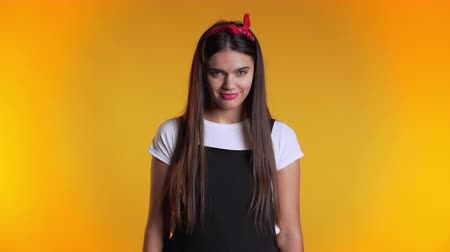 transação : Young pretty woman on yellow background showing middle finger - gesture of fuck. Expression negative, aggression, provocation.