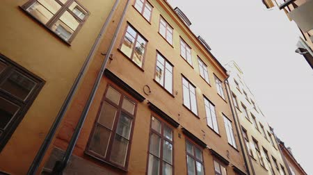 Apartment building streets in old northern european city. Scandinavian windows. Facades of colorful houses in the streets of Sweden. Traveling concept. Wideo