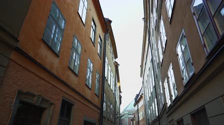 Apartment building streets in old northern european city. Scandinavian windows. Facades of colorful houses in the streets of Sweden. Traveling concept. Slow motion. Wideo