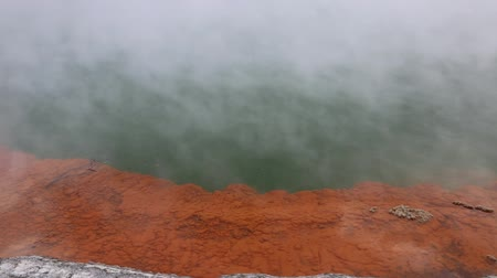 wai o tapu : Orange mineral crust of Champagne Pool, New Zealand Stock Footage