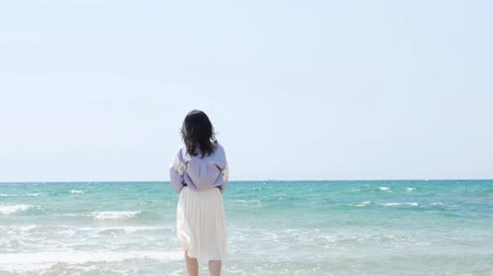 двадцатые годы : Asian woman standing at the beach