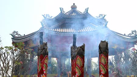 наследие : Huge joss stick,Chinese house background.