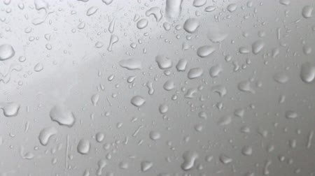 vízcseppek : Abstract background of water drops and flow on glass