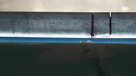 iron metal : Slow motion Close up water leak drop from steel pipe.