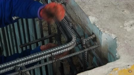 metal worker : Construction worker connect reinforcement deform bar with binding wire.
