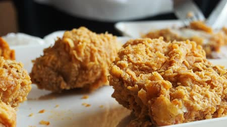 tavuk : Eating Fried chicken in fast food restaurant camera slide slow motion.