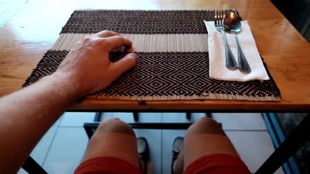 starving : Caucasian man sitting in cafe and waiting for lunch or dinner. He nervously knocks his fingers on the table.